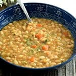 This gluten free and vegan White Bean Soup is warm, creamy, and tastes wonderful! You can make it in your Instant Pot or slow cooker making it the perfect dinner option! #glutenfree #vegan #dairyfree #soup #slowcooker #instantpot