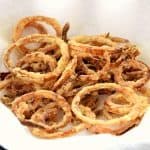 These crispy onion straws are gluten free, dairy free, and taste amazing! They are the perfect topping for your burger, salad, or just to eat as a snack! Gluten Free | Dairy Free | Vegan | Gluten Free Recipes #glutenfreerecipes #dairyfreerecipes
