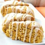 These Pumpkin Scones have a delicious pumpkin and warm spice flavor making them the perfect treat for Fall! They are gluten free, vegan, and topped with a spiced maple glaze. #glutenfree #dairyfree #vegan #scones #breakfast #recipes #fall