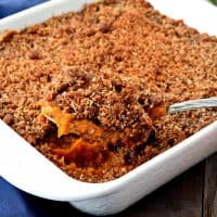 This easy gluten free and vegan sweet potato casserole with coconut streusel topping is delicious! It's the perfect side dish to bring to your next family gathering! #glutenfree #dairyfree #vegan #thanksgiving #sweetpotatocasserole #sides