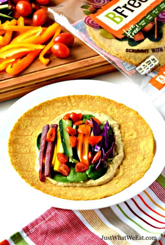 These gluten free and vegan Veggie Hummus Wraps are delicious and easy to make! They are filled with colorful vegetables and creamy hummus. #glutenfree #vegan #dairyfree #healthy #lunchideas #dinner